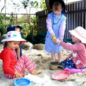 girls in sandpit